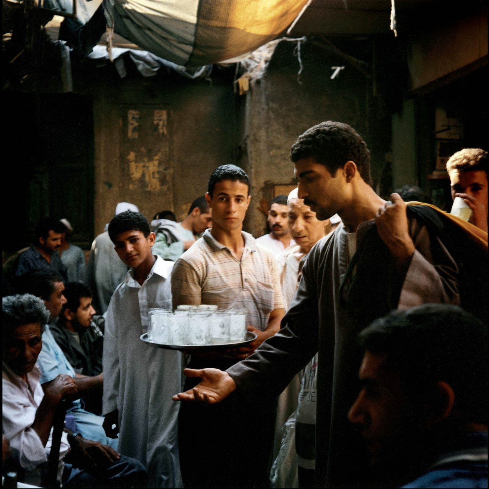 A limonade salesman in the souk, Cairo, 2000 photograph by Denis Dailleux