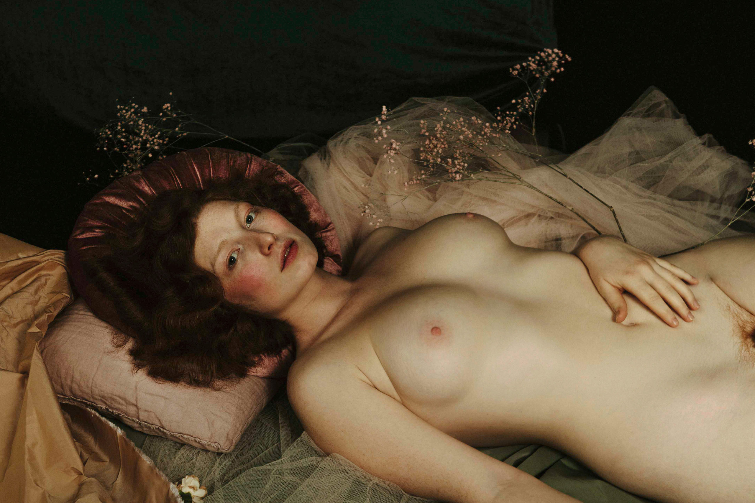 Painterly portrait of a naked woman with red hair