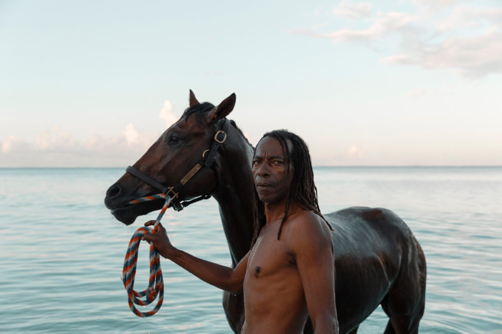 A groom from the Savannah Garrison Turf Club in Barbados exercises a race horse at Pebbles Beach.