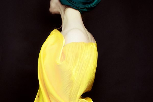 colorful studio portrait of a woman wearing a yellow outfit - photograph by Anastasia Ermolenko