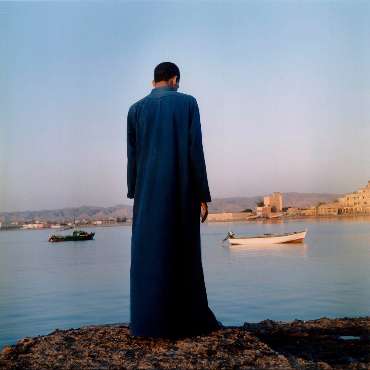 Man looking at the Red Sea, El Qusier, 2003 photograph by Denis Dailleux