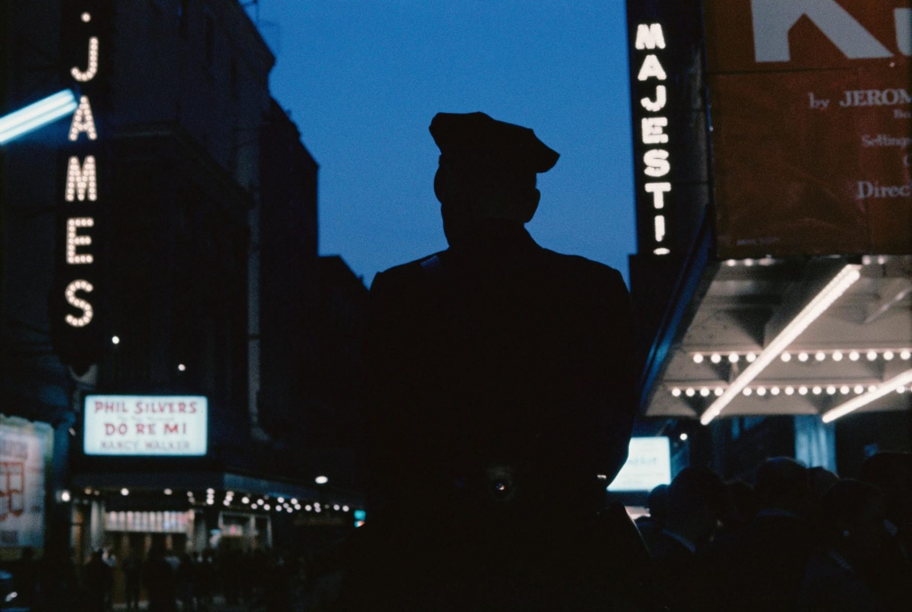 Photograph of a police officer in New york, USA at night. Image by Gordon Parks