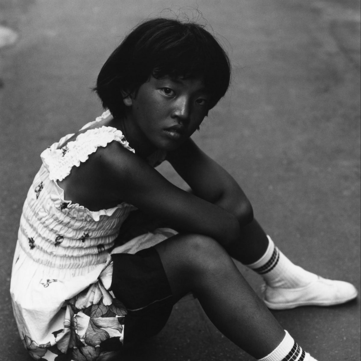 Black and white portrait of a young girl in japan by Issei Suda