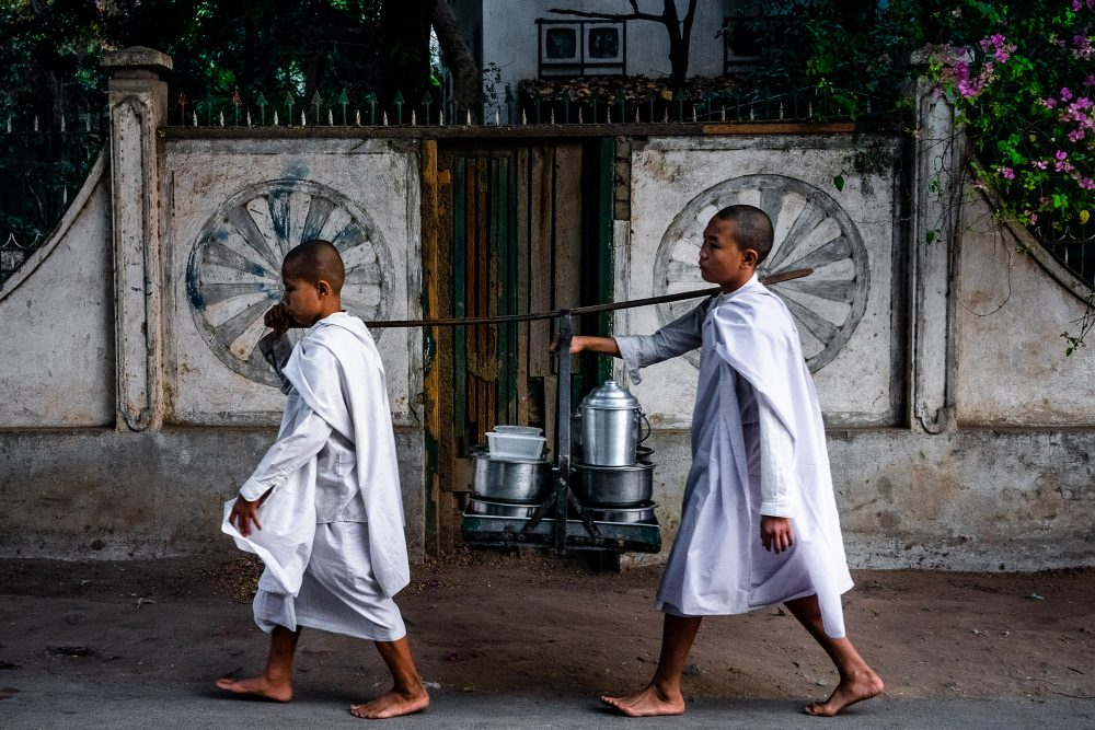 Travel Photography by Alex Zyuzikov - two young monks in the street of Mandalay, Myanmar