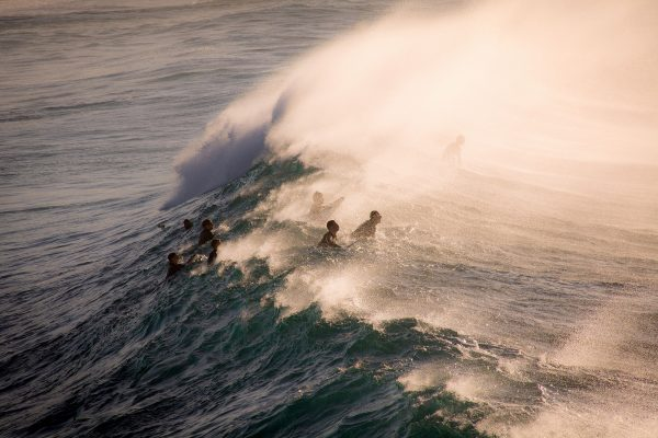 Travel photograph by Alexander Smiley of surfers riding waves at Bronte beach, Australia