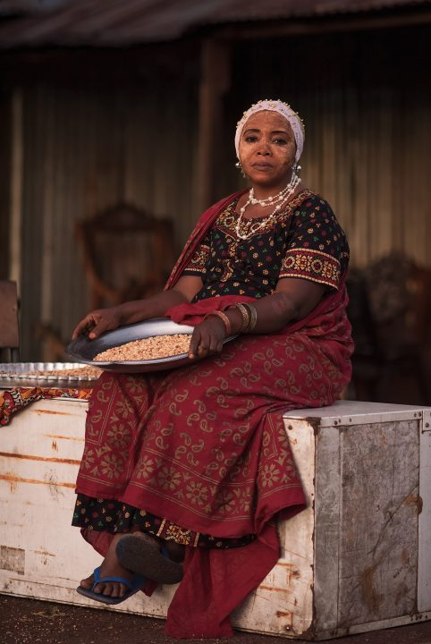 Travel photograph and portrait of a woman in Comoros by Djamil Kemal
