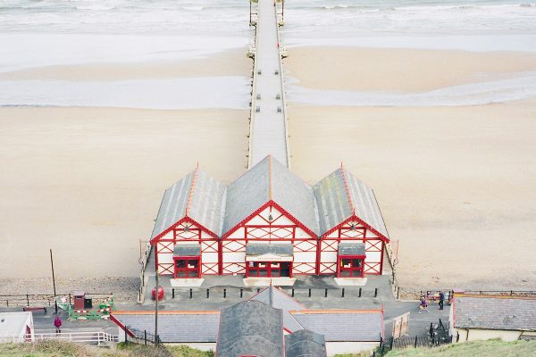 Travel photograph by Frank Lassak of the beach and Saltburn Pier, United Kingdom