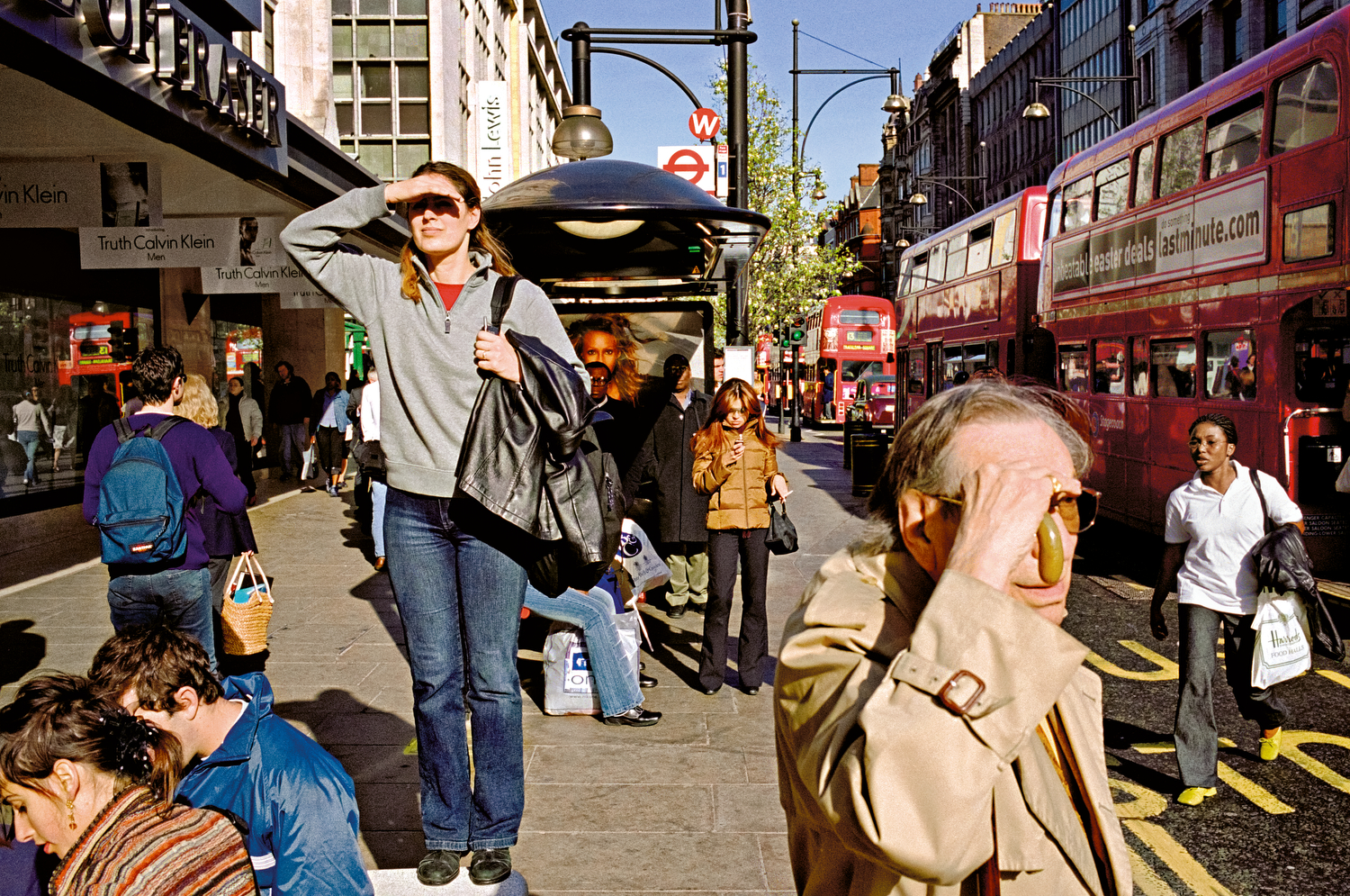 Color Street Photograph of people on Oxford Street, London by Matt Stuart