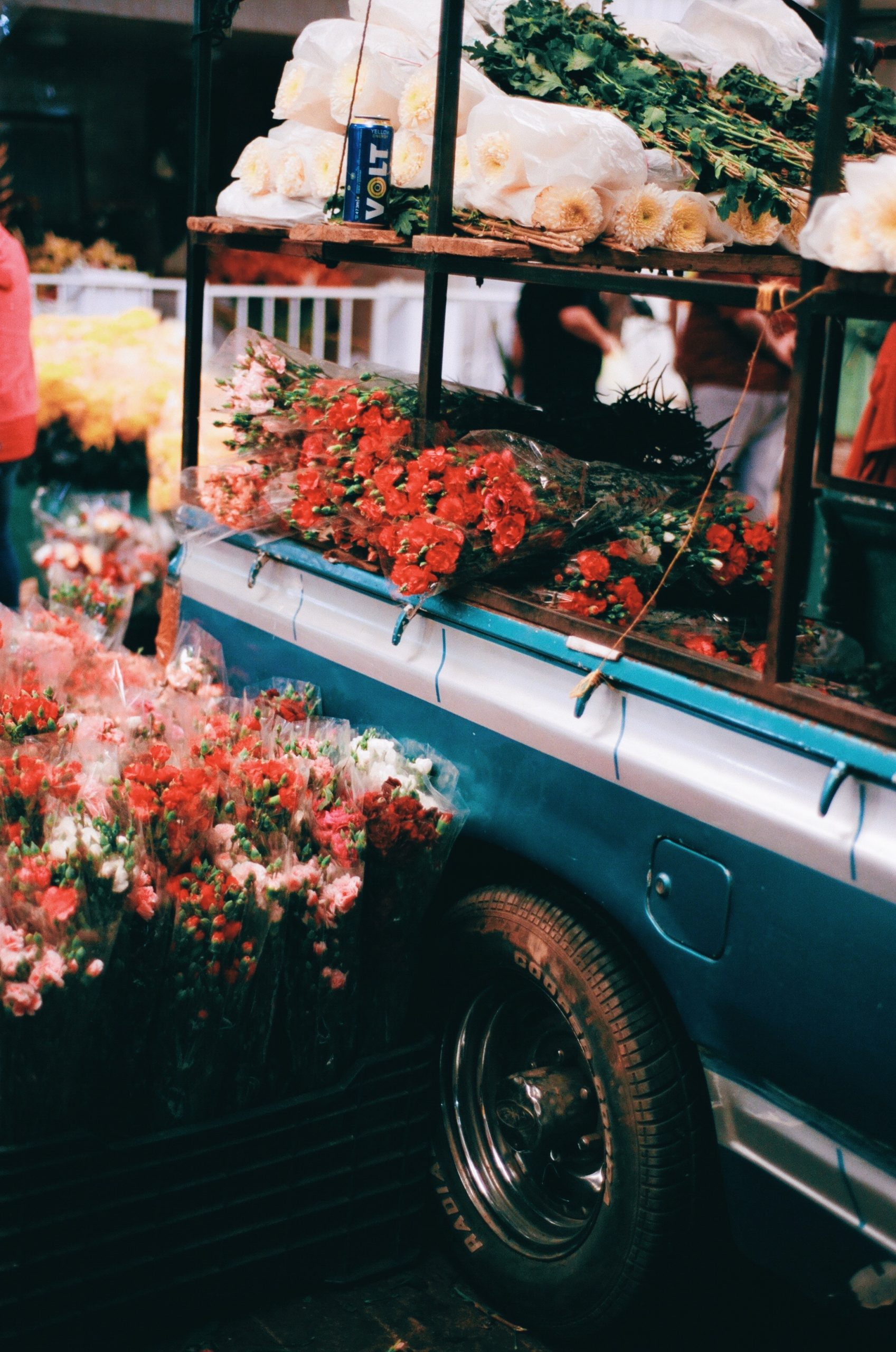 Color street photography by Pia Riverola, flowers in truck