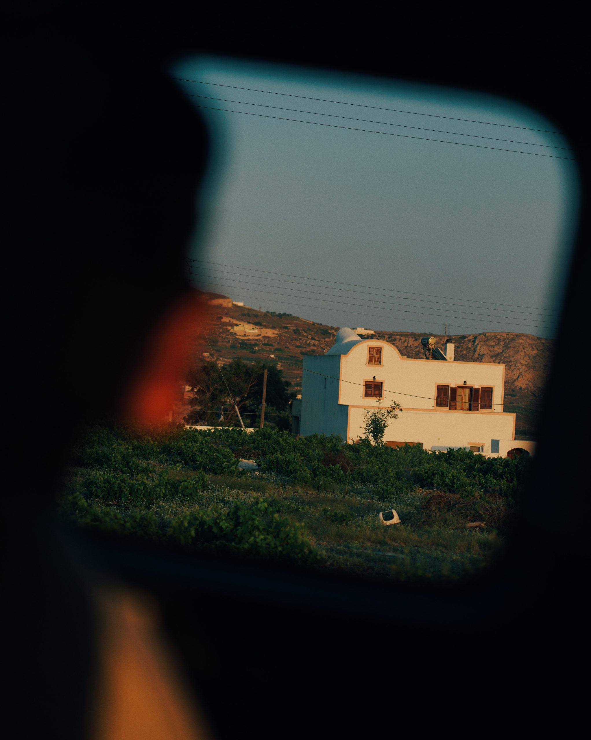 Color street photography by Pia Riverola, house, driving Greece