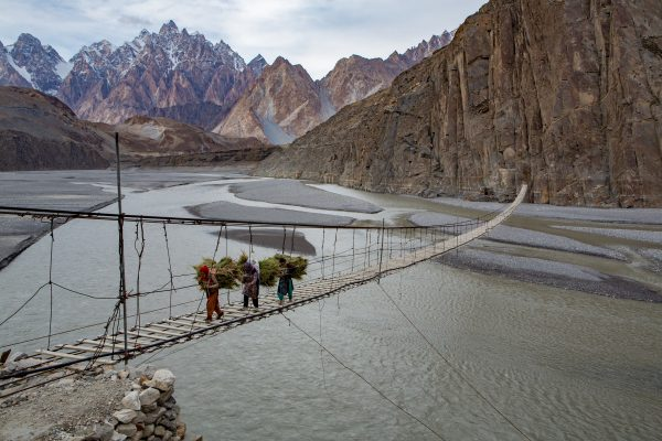 Travel Award - color photograph of people crossing river in Pakistan by Jørgen Johanson