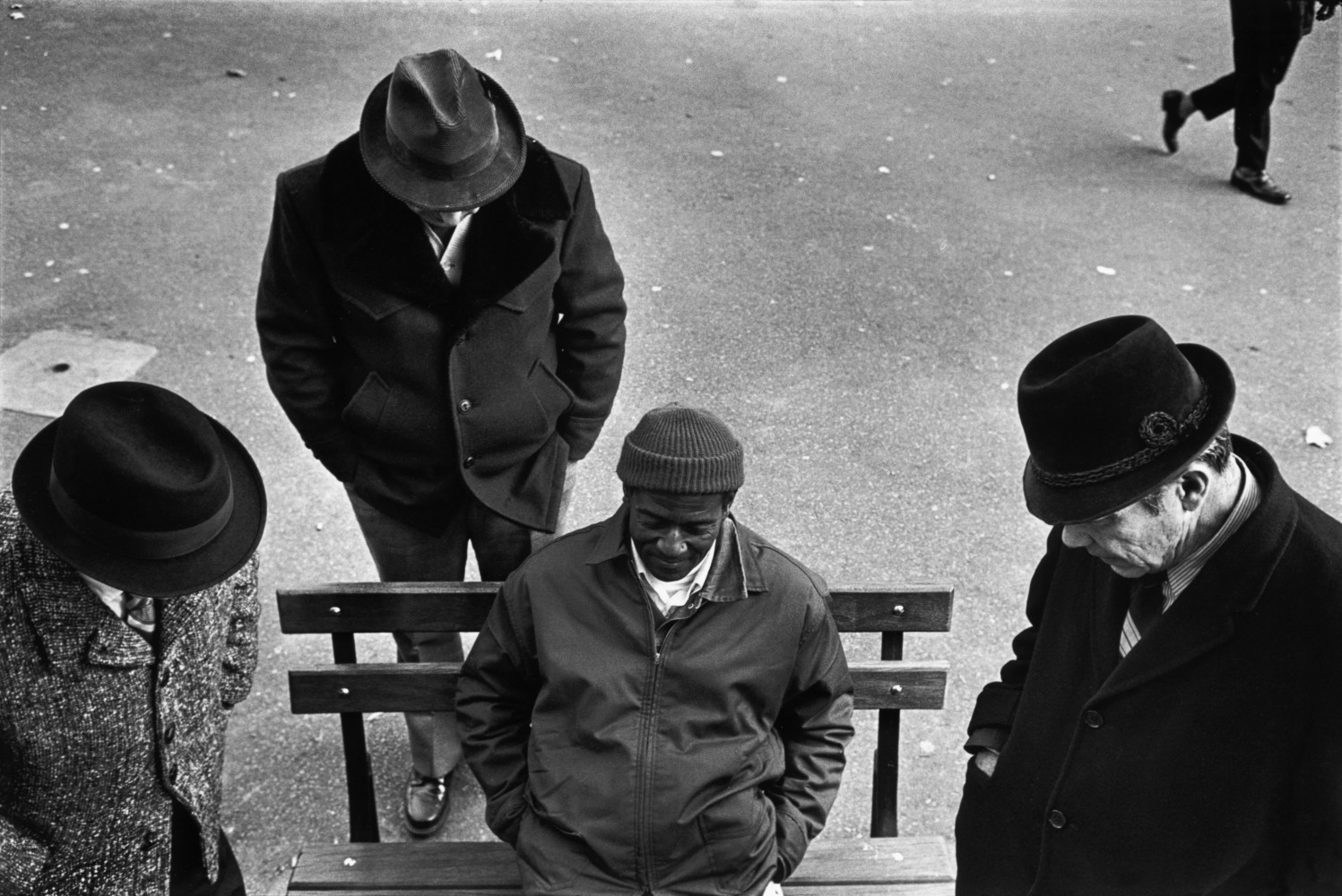 Black and white street photography by Richard Kalvar, a group of men in Washington Square, New York City.