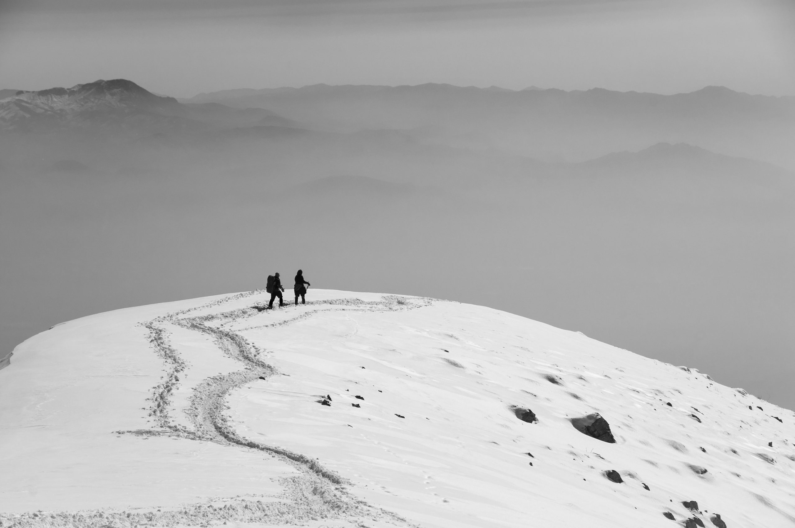 Black and White photo by Payam Hamzei of two women climbing Darabad Mountain, north of Tehran, Iran