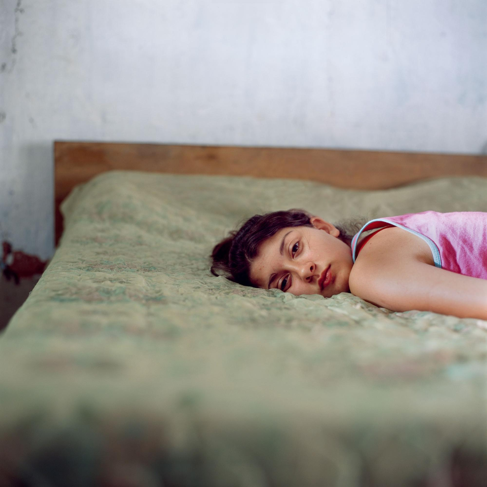 Color portrait of a girl by photographer Alessandra Sanguinetti