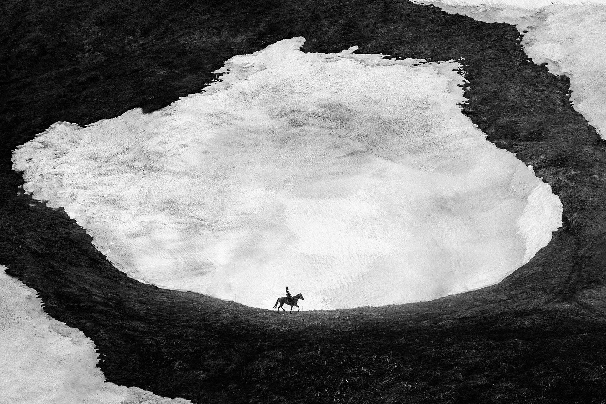 Black & white photograph, landscape, man, horse
