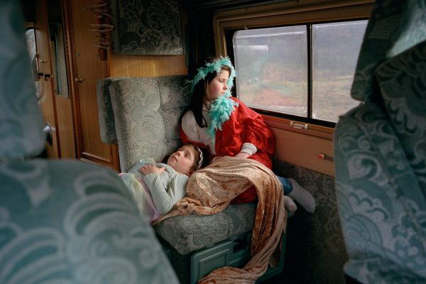 Color photograph of 2 kids in a caravan, 2nd prize of the People Competition