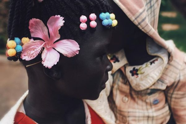 color portrait photograph of a young Sudanese girl by photographer Ebti Nabag