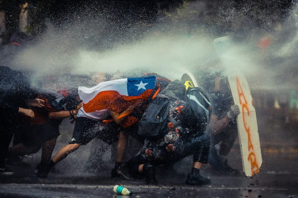 Color documentary photograph by Javier Vergara of Chilian protestors in Santiago, Chile, on November 11th, 2020