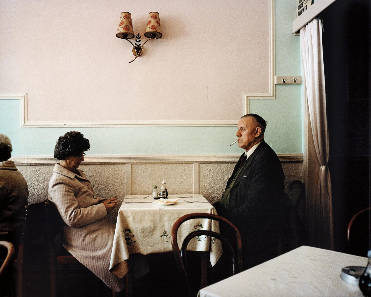 Color photo by Martin Parr elderly couple dining, New Brighton, England, 1980s
