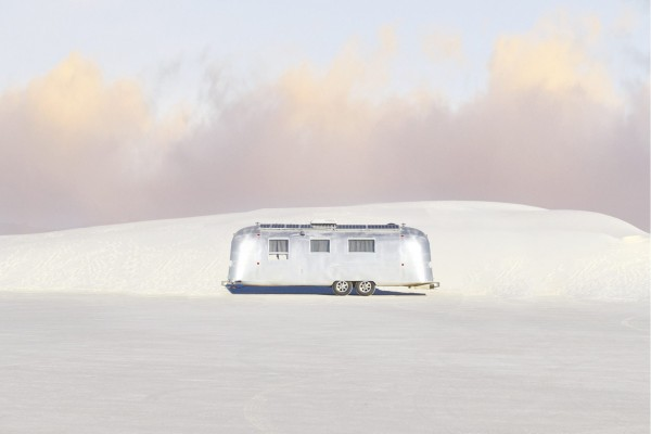 Open Call - color photograph of a trailer in white sand dunes landscape in the USA by James Needham