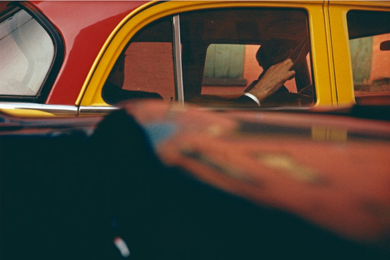 Color photo by Saul Leiter, yellow and red taxi, NYC