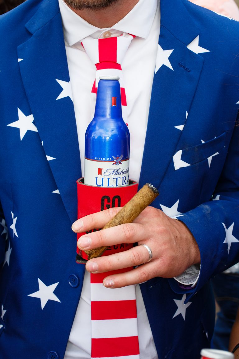 Color photo by Martin Parr, man with beer and cigar and USA flag suit, Kentucky Derby