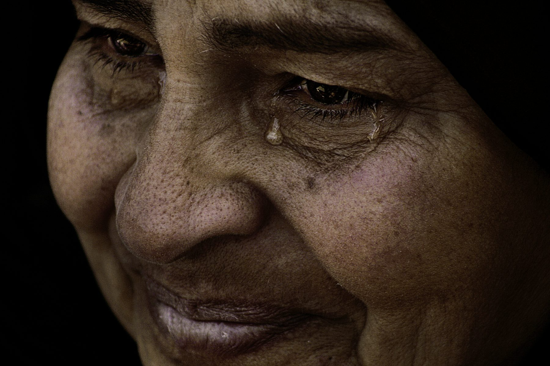 Color photo by Laura El-Tantawy from IN THE SHADOW OF THE PYRAMIDS. Cairo, Egypt, Revolution, woman crying