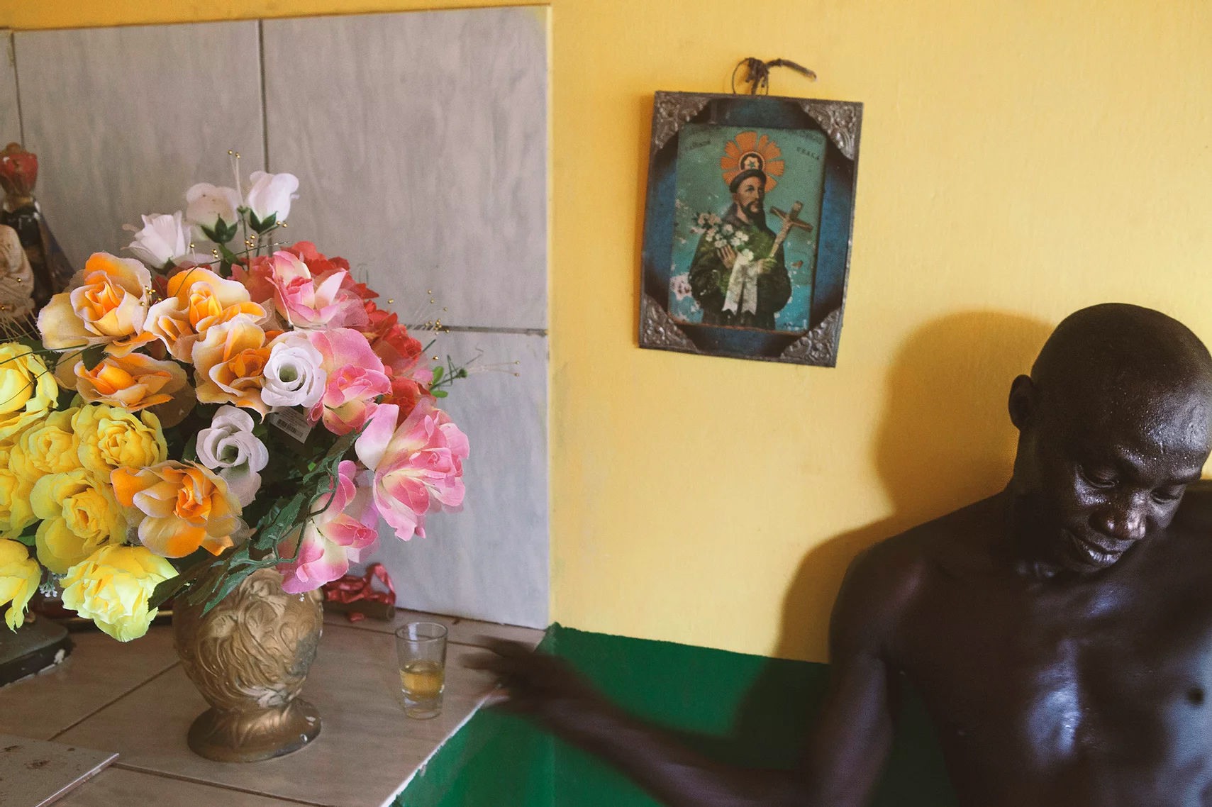 color photo by Alex Almeida from Brazil Tropical light. man at home, flowers.