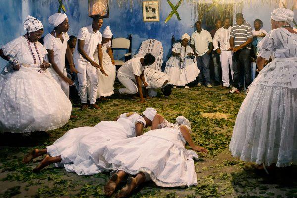 color photo by Alex Almeida from Brazil Tropical light. religious ceremony.