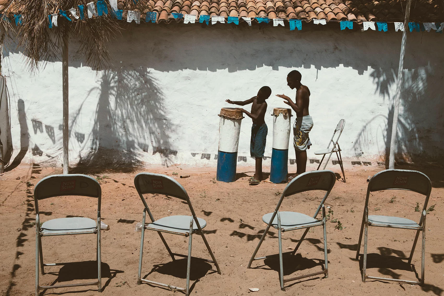 color photo by Alex Almeida from Brazil Tropical light. boys playing drums.
