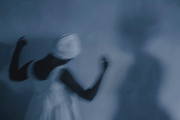 color photo by Alex Almeida from Brazil Tropical light. woman dancing, praying.