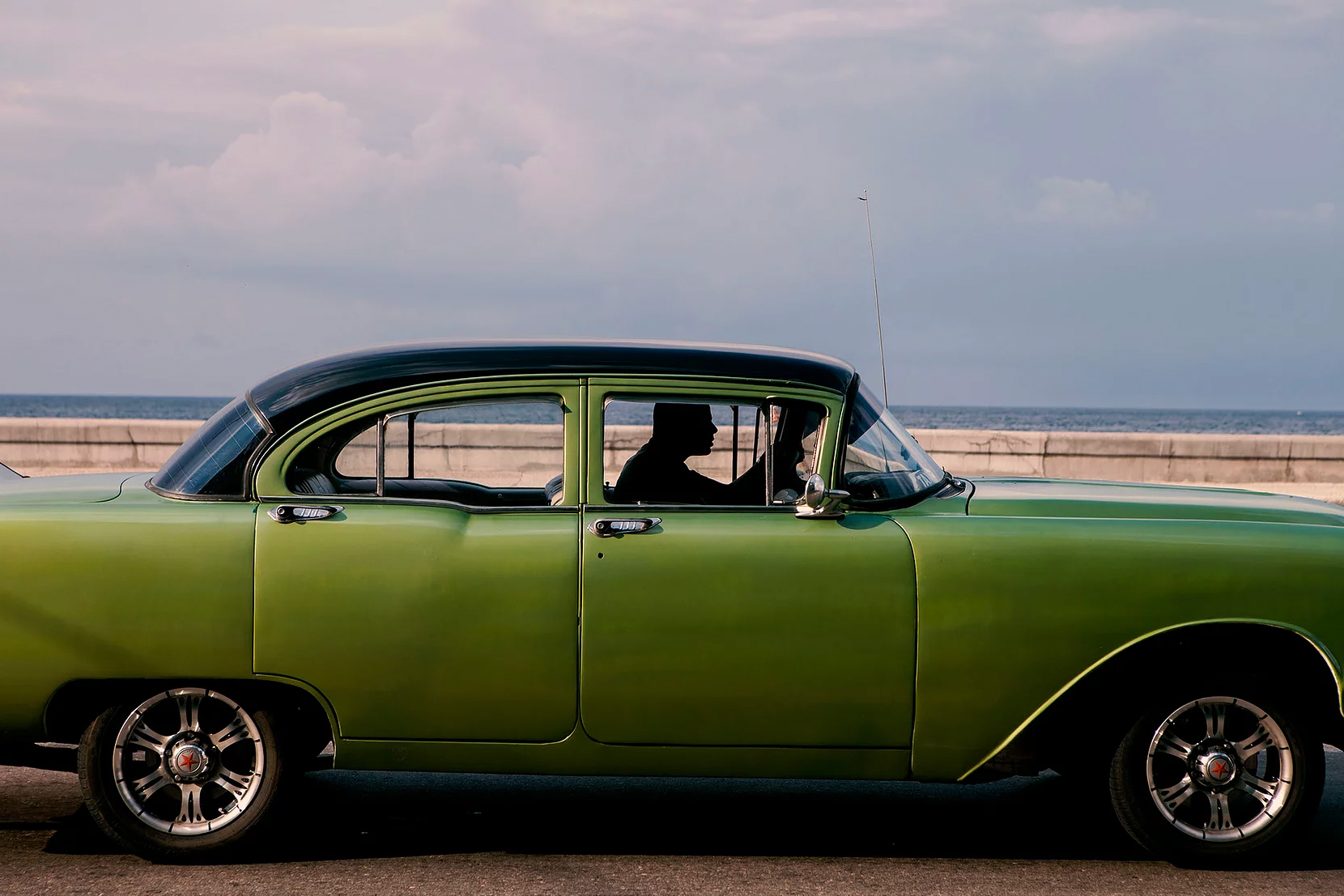 Color photo by Alex Almeida, vintage green car Cuba.