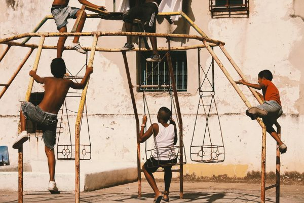 Color photo by Alex Almeida, kids on swings Cuba.