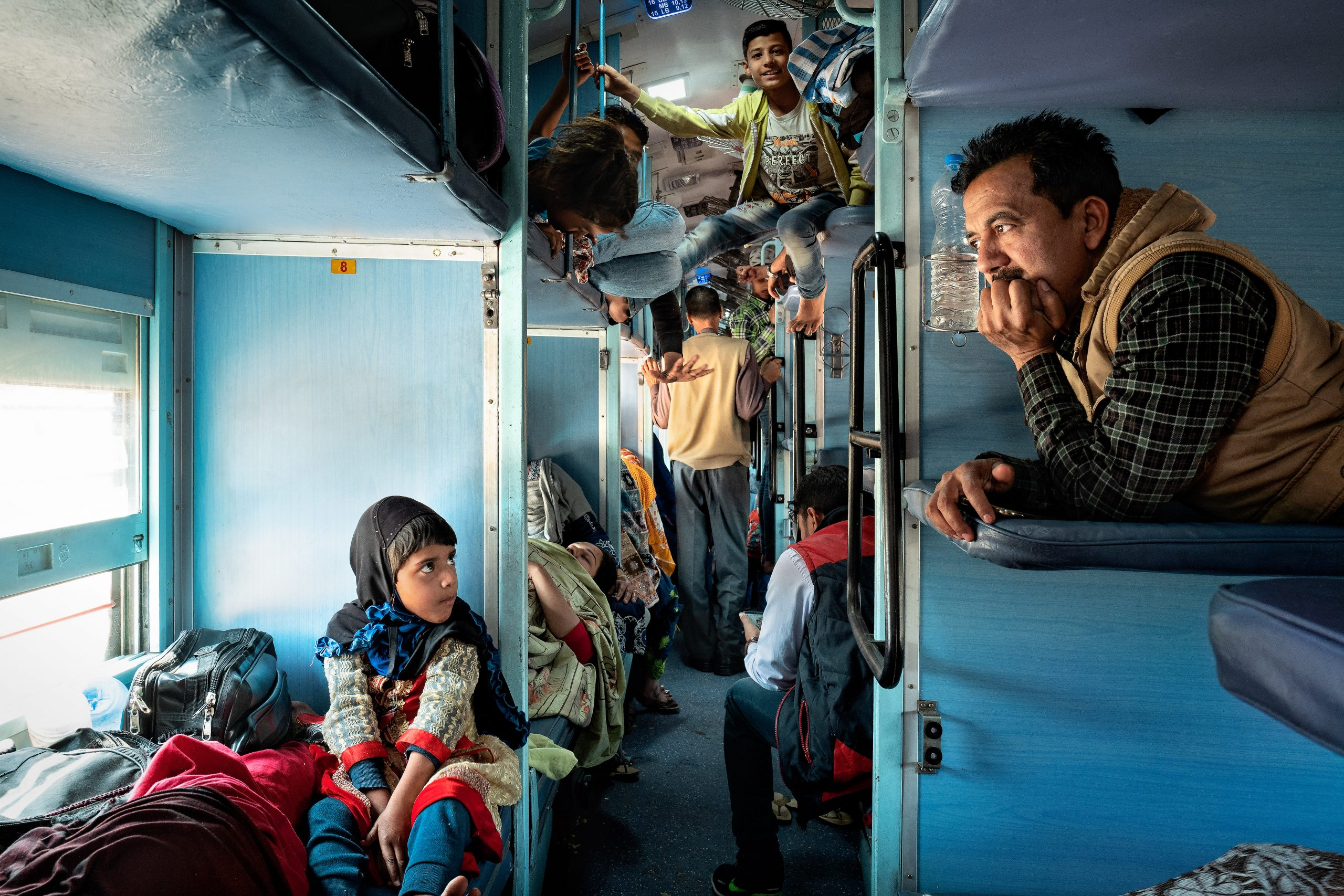 street color photograph of people in a train shot in Jaipur, India, by Giuliano Lo Re