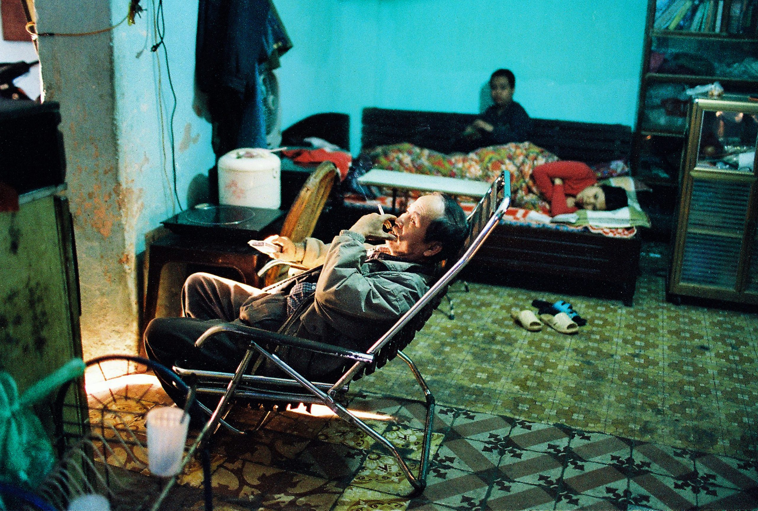 Color photo by Maika Elan from Inside Hanoi. Family watching television.