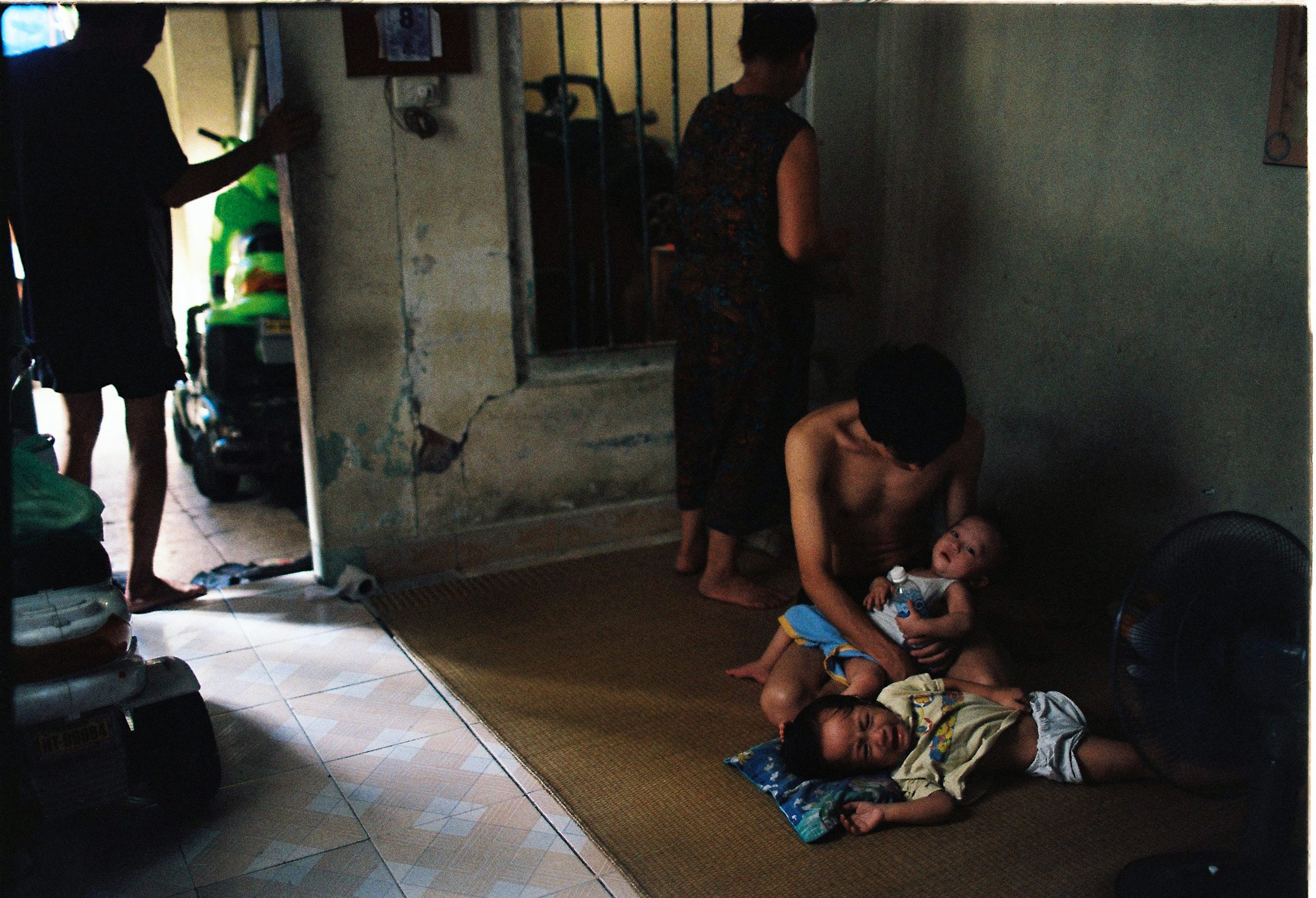 Color photo by Maika Elan from Inside Hanoi.Father and child.