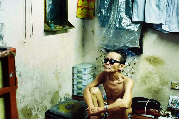 Color photo by Maika Elan, man watching television, from Inside Hanoi