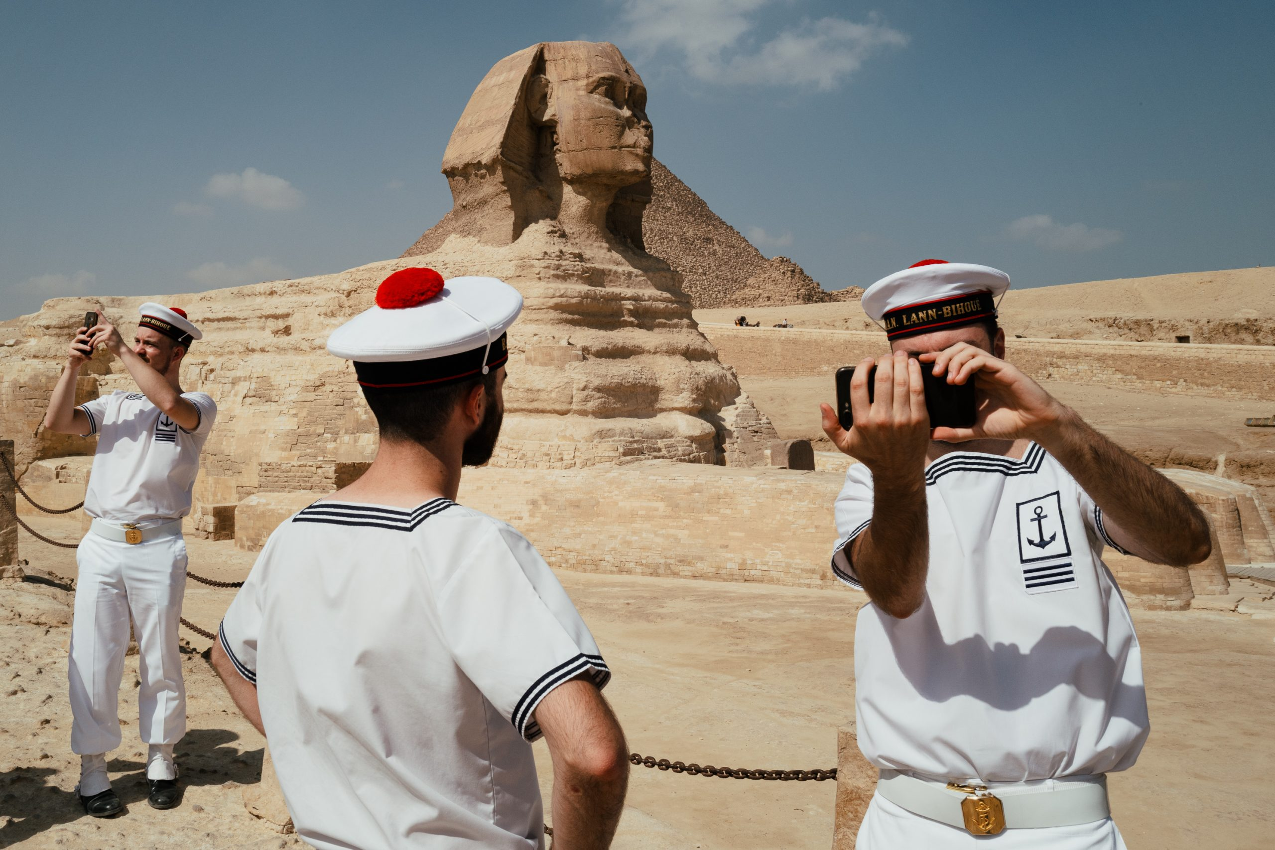 color street photography of French Navy sailors in front of the Sphinx in Egypt by Jonathan Jasberg