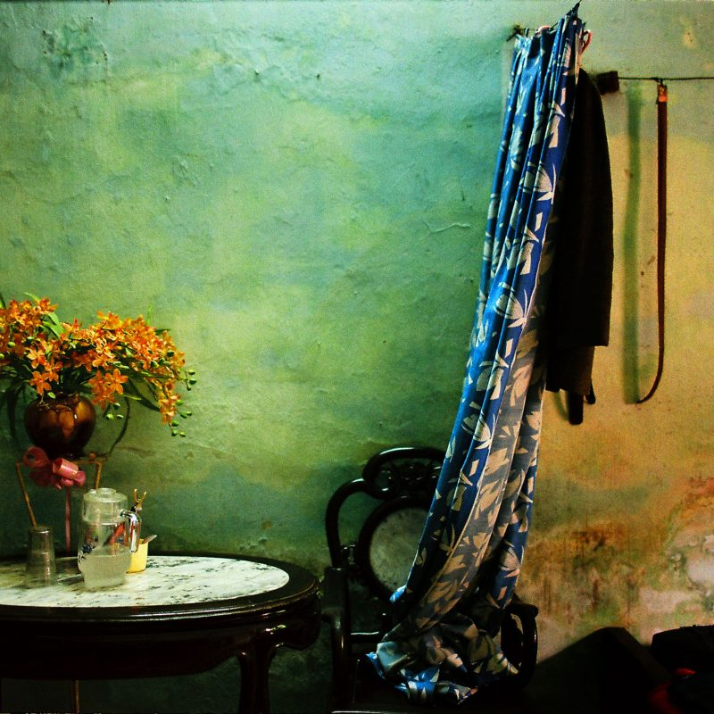 Color film photograph of a bedroom in Hanoi, Vietnam by Maika Elan