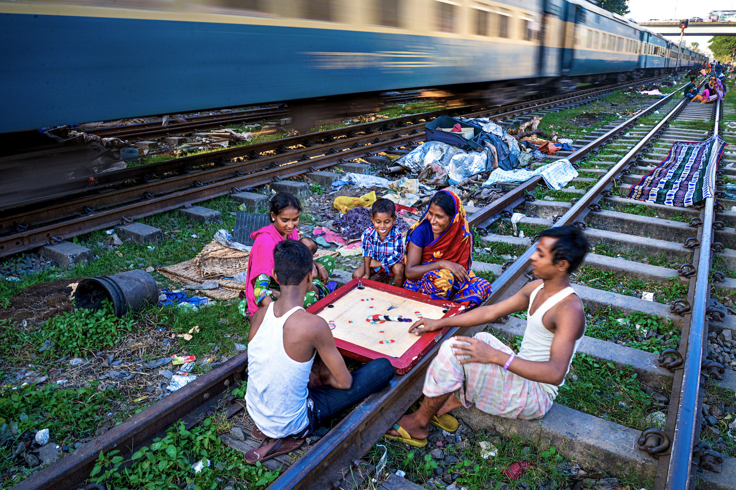 color street photography of a family and train in India