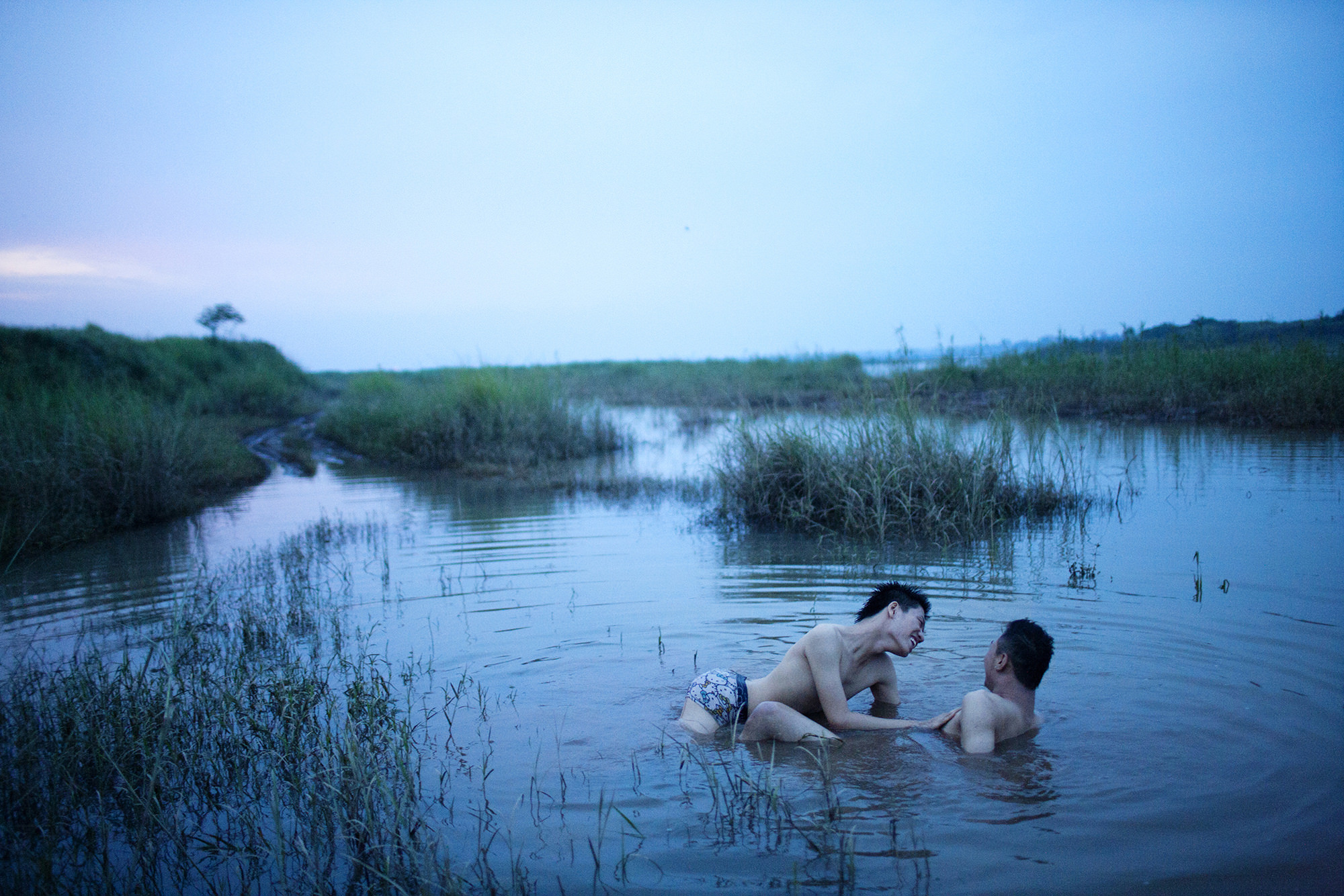 Color photo of gay couple by Maika Elan from the series 'The Pink Choice'