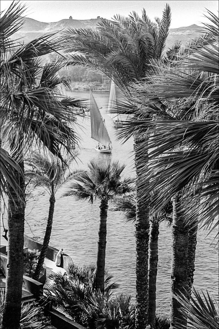 Black and white photo by Xavier Roy. Asswan Egypt coast, yachts, ocean, palm trees.