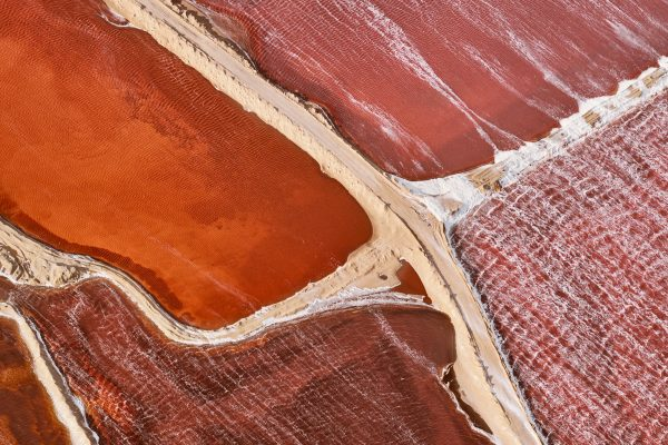 aerial colorful landscape photograph of Salt flats near Walvis Bay, Namibia by Brooke Holm