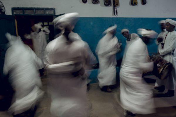 color street photograph of dancers in Morocco byJorge Delgado-Ureña