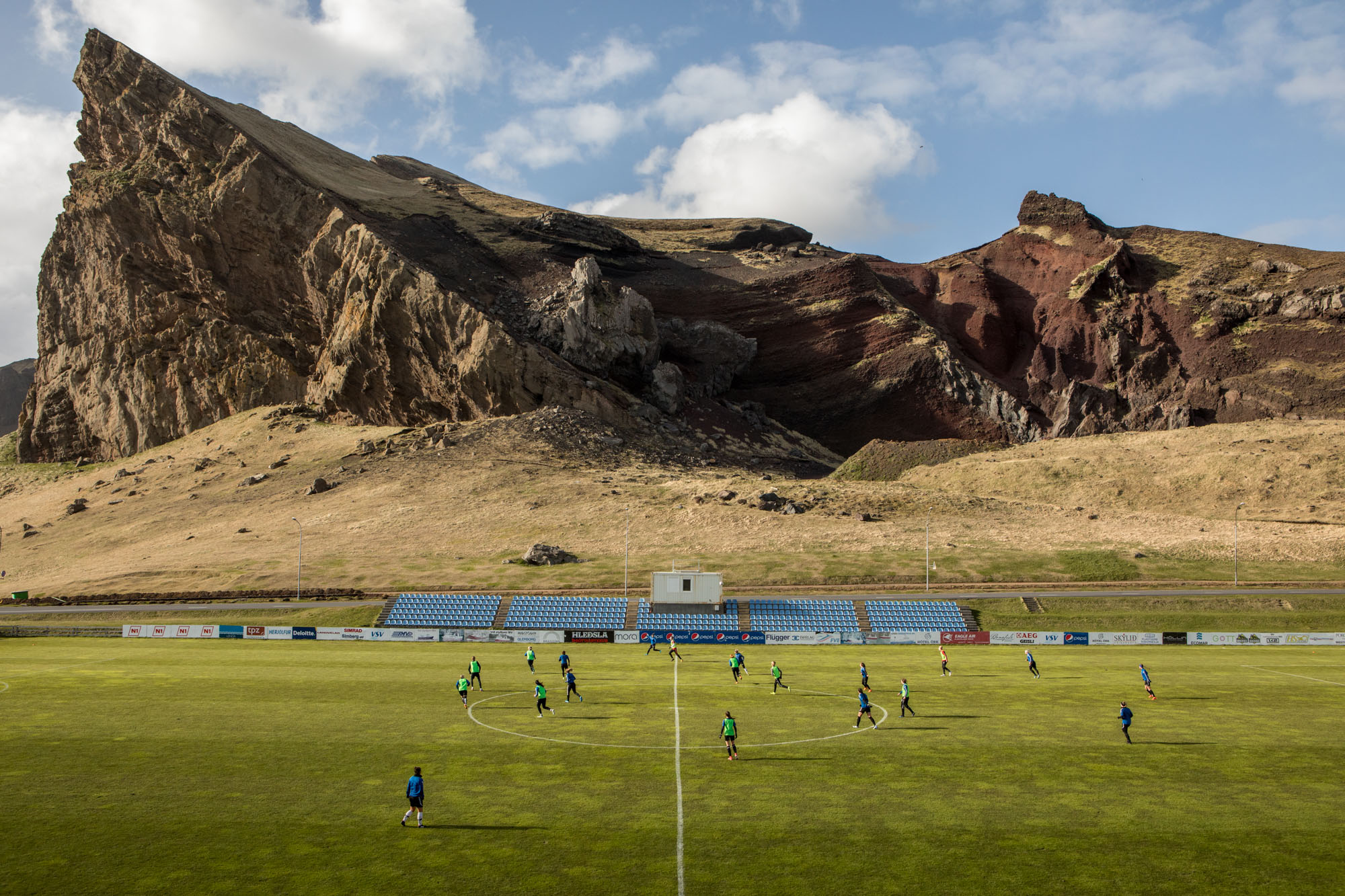 lanscape color photograph of Female football training in Heimaey, Iceland by Matteo de Mayda