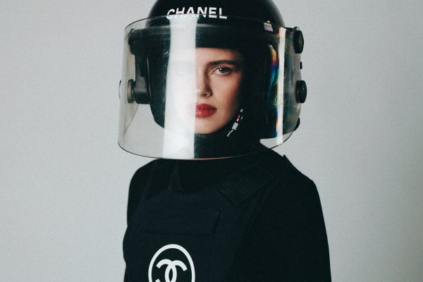 Fashion color studio portrait of a woman wearing chanel by Milan Miguel