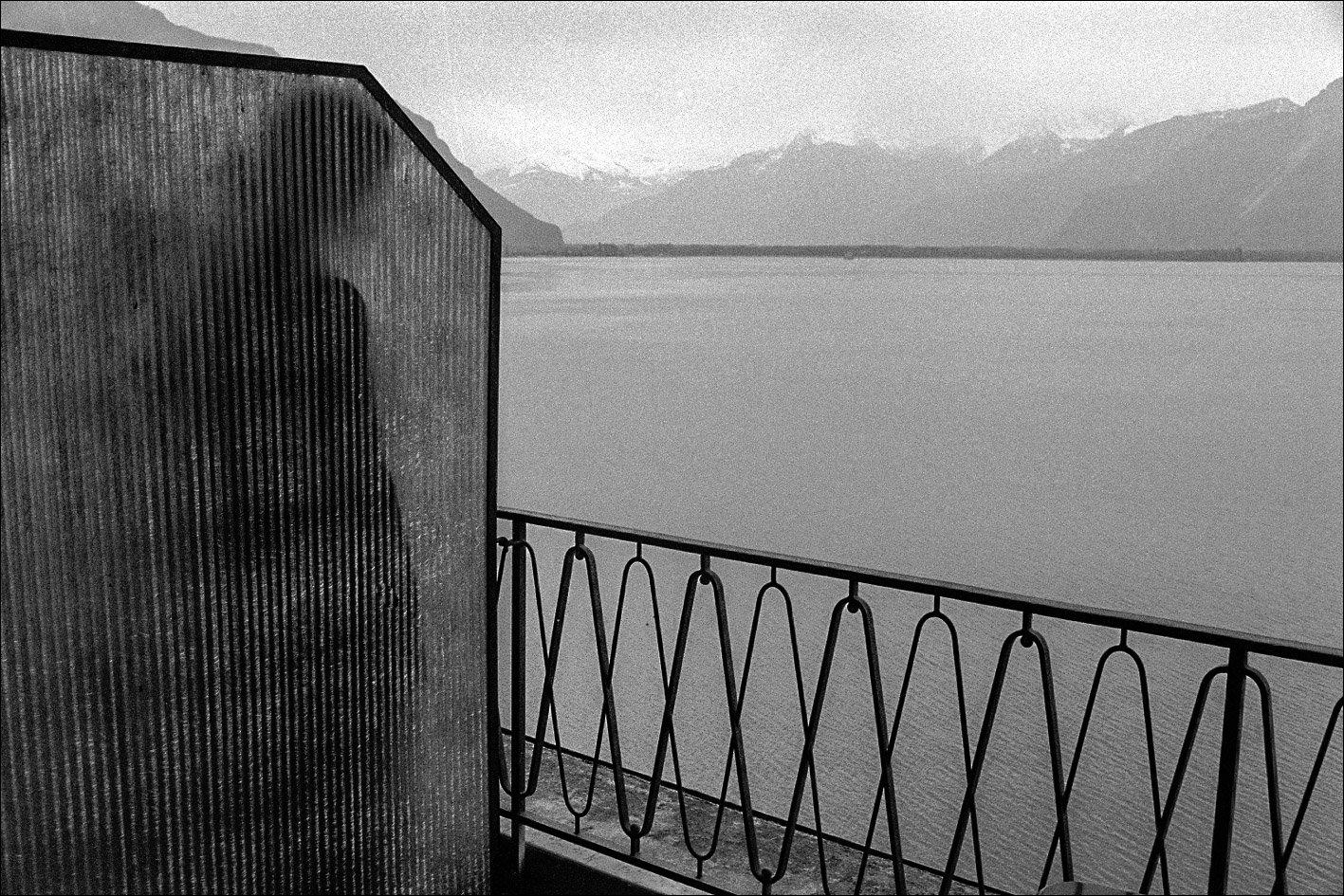 Black and white photo by Xavier Roy, mountains, lake, balcony, Montreux, Switzerland