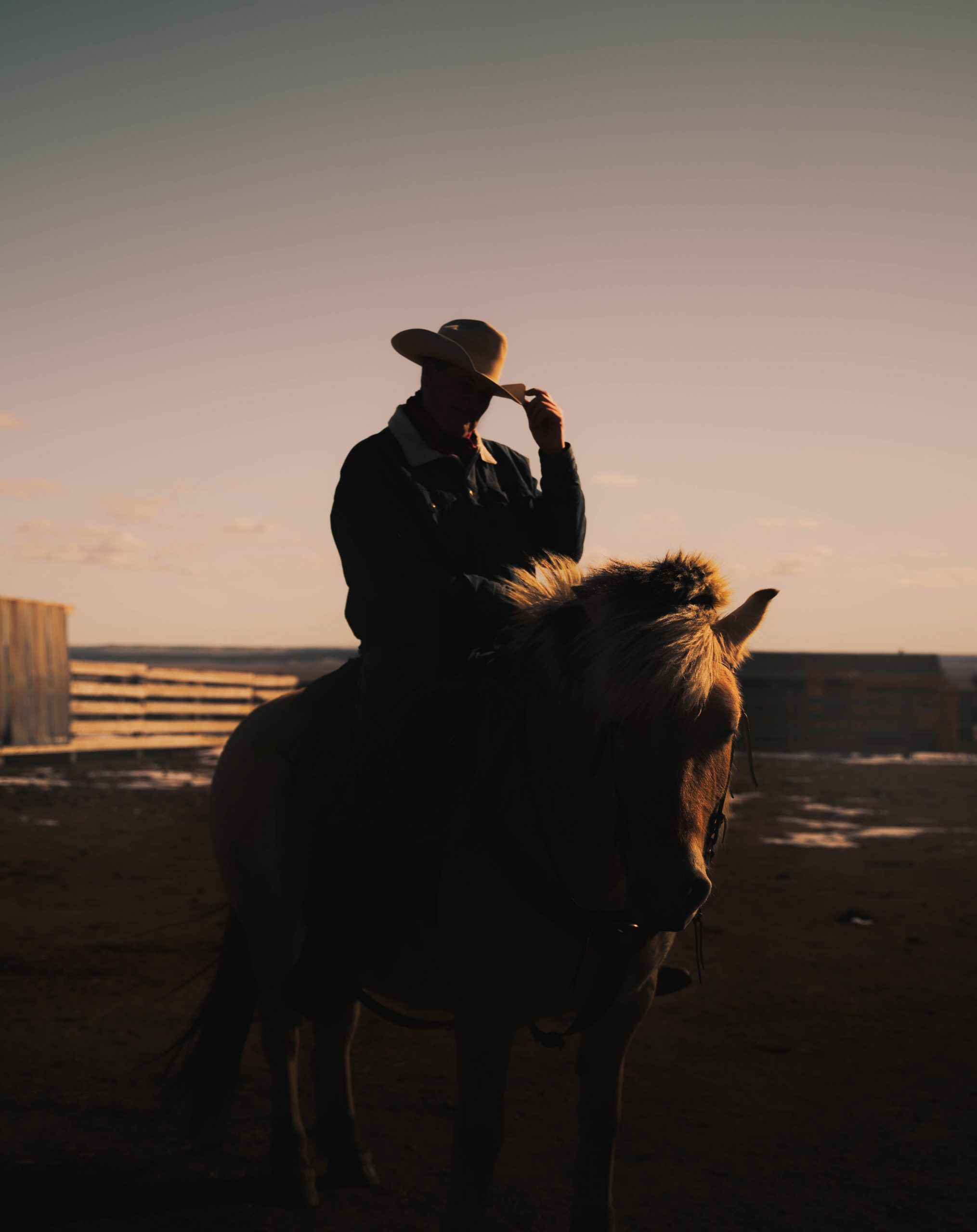 color portrait photograph of a man and his horse in Dakota, USA by Noam Azouz