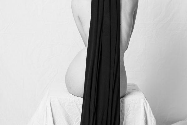 black & white studio fineart portrait of a woman by Saman Majd