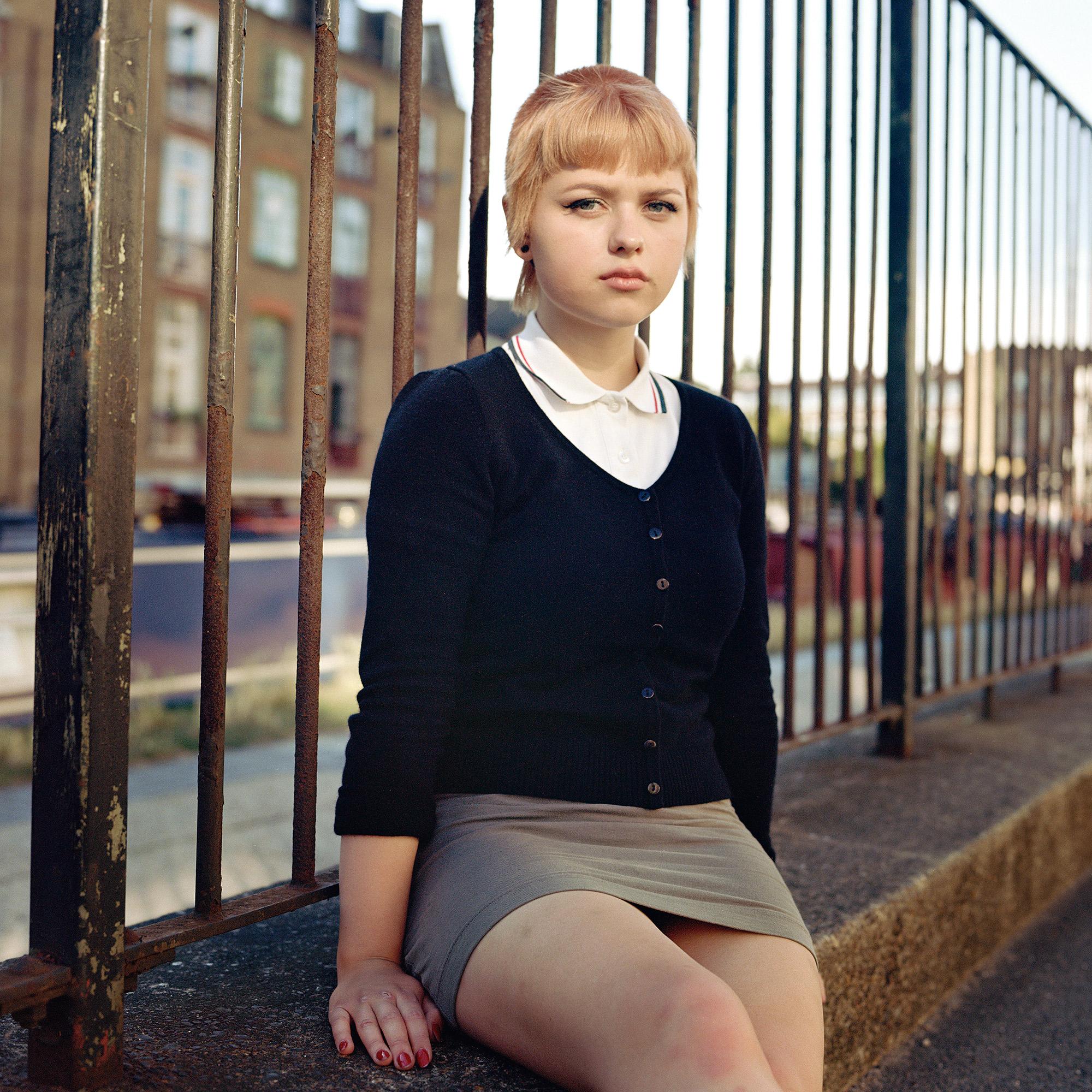 medium format analog color portrait of a skinhead girl in London, UK by Owen Harvey